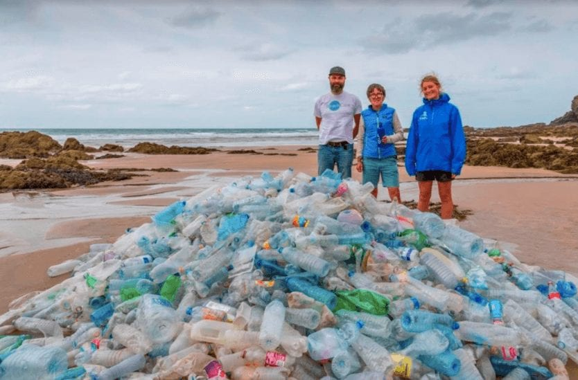 Refill Cornwall team on beach with plastic bottles